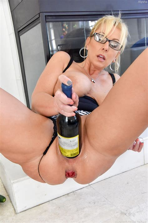 Big Boobed Blonde Milf Inserts Huge Toys And A Bottle Into