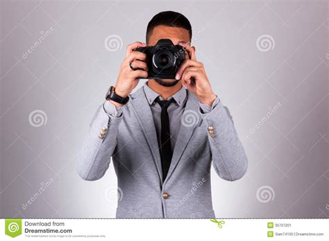 African American Photographer Holding A Dslr Camera