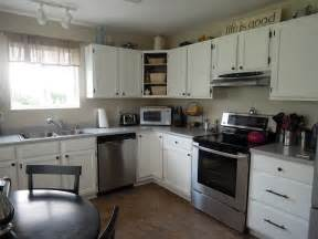 marvelous l shaped white cabinets with black rounded breakfast table set also grey wall painted