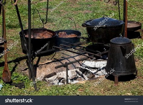 fire iron cast pot pots coffee cooking open cooked pans food camp outdoors shutterstock alamy comp