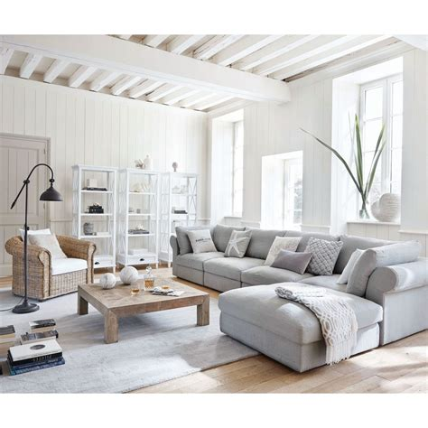 The simplicity is coming from the regular shapes of the furniture, the good organization of elements in the room and the free space around. 18 gorgeous grey living room ideas   Real Homes
