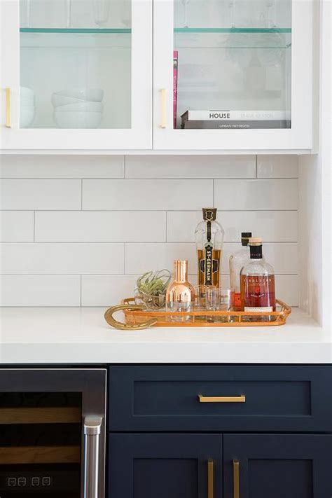 Navy Blue Kitchen Cabinets with Overhead Glass Cabinets