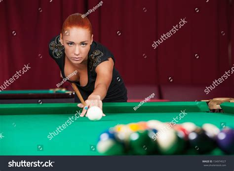 Sexy Pool Player. Beautiful Young Red Hair Woman Playing