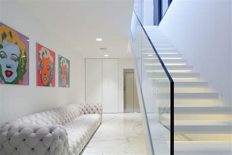 Long Tufted Sofa by Amazing Glass Staircase Without Handrails Also Modern