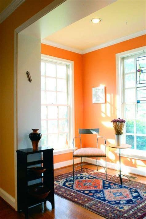 orange wall  white trim  fun   small sunny room