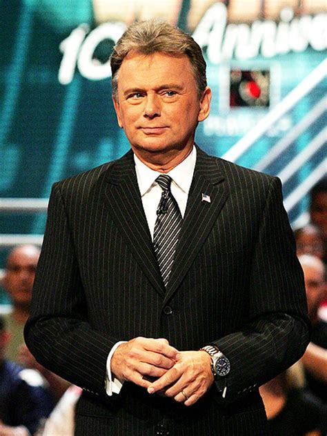 pat sajak walks  wheel  fortune set wheel