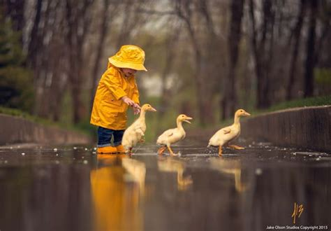 girl  yellow rain slicker   yellow ducks