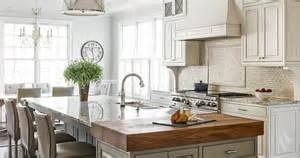 kitchen island with cooktop tumbled marble kitchen backsplash transitional kitchen