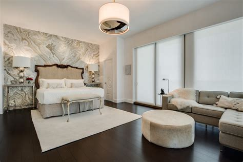 colosseo marble bookmatch feature wall in master bedroom