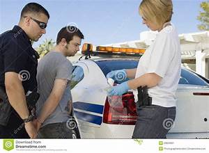 Police Officer Arresting Young Man Stock Image - Image ...