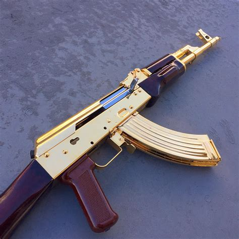 progress gold plated ak almost back together guns