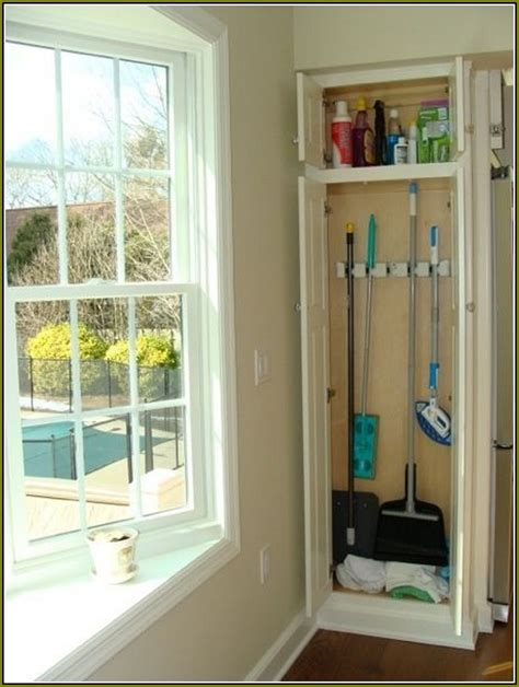 broom closet cabinet wood home design ideas