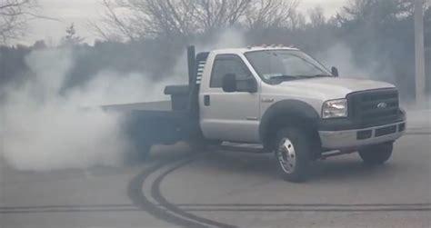 tire smokin   diesel rolls coal  smokes