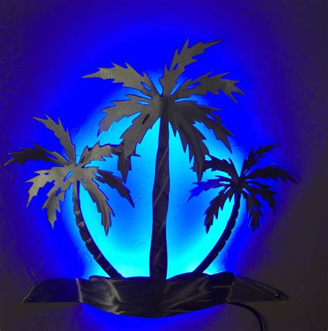 This poinsettia christmas tree is a great wall decoration. Palm tree wall sconce wall light beach house decor LED