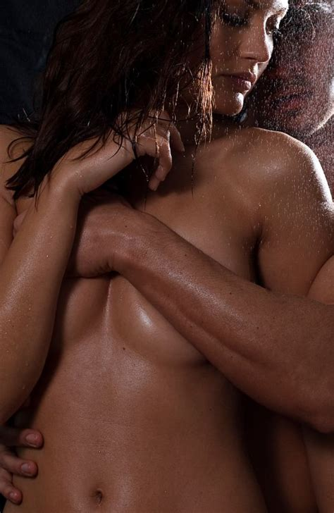 Loving Nude Couple Engaging In Sexual Games Foreplay And