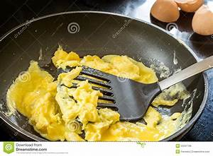 Frying Scrambled Eggs In A Pan Black Stock Photo - Image ...