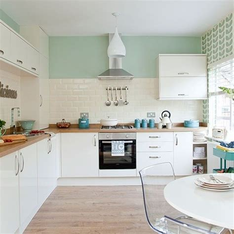 mint green kitchen accessories traditional kitchen with pastel green walls decor 7521