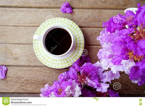 Cup Of Coffee With Spring Purple Flower On Wooden Background Stock Photo   Image: 73525439