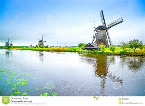 windmills  canal  kinderdijk holland  netherlands
