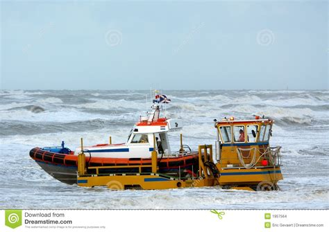 Boat Driving Into Helicopter by Coast Guard Stock Images Image 1957564
