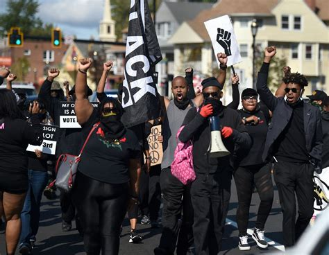Armed Black protestors march in Hartford's North End to ...