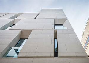 Angled openings create balconies across the facade of MORA ...