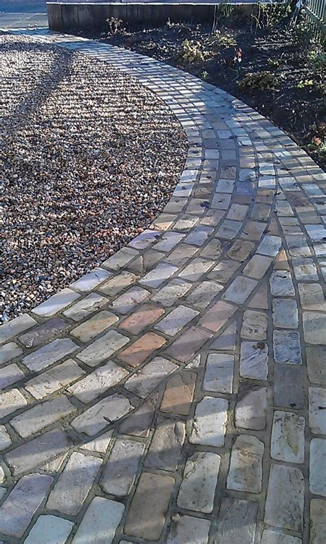 laying paving slabs on soil how to lay sand install lawn