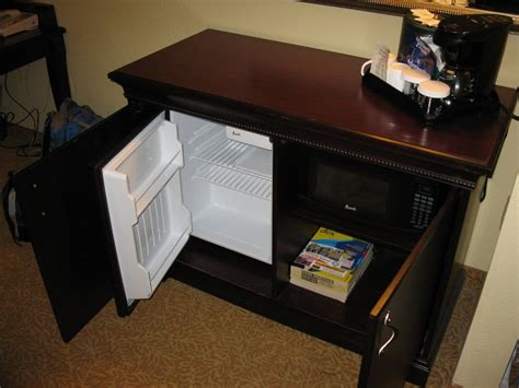 mini fridge microwave cabinet a cabinet opens to reveal this mini fridge and a microwave