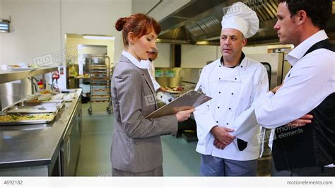 cuisine am駭ager restaurant manager chatting with waiter and c stock footage 4692182