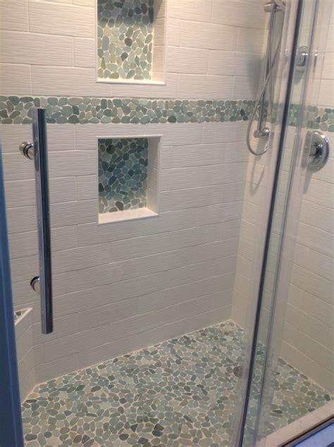 large sliced sea green pebble tile shower floor  niche