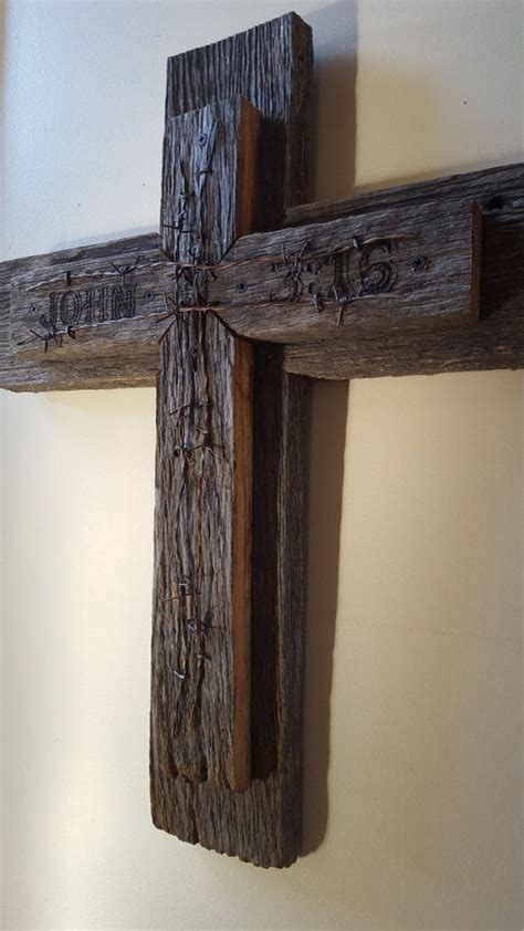 year  barnwood cross  barbed wire