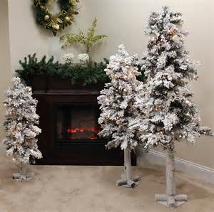 set of 3 pre lit flocked woodland alpine christmas trees 3 4 and 5 clear