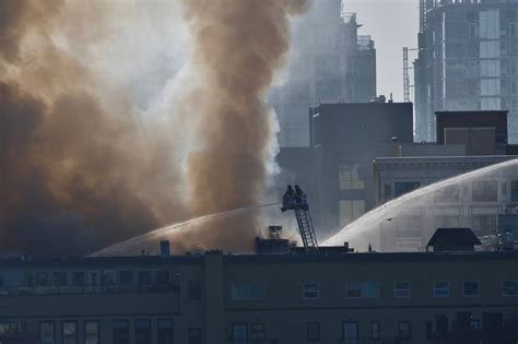 update building partially collapses  raging fire