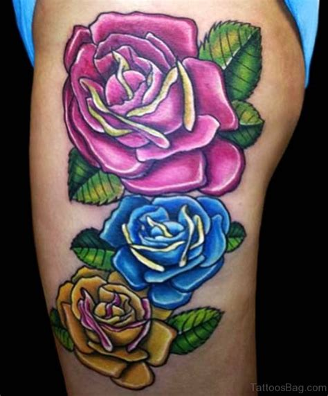 lovely blue rose thigh tattoos