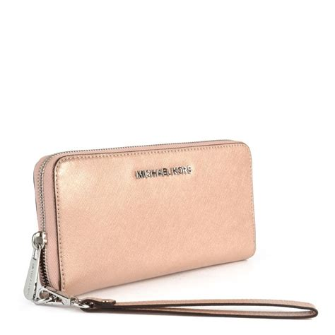 michael by michael kors jet set travel multifunction pink