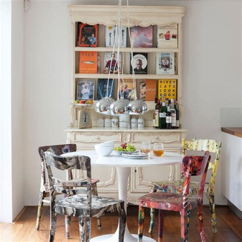 eclectic dining room with painted chairs dining