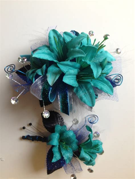 teal keepsake prom corsage and matching boutonniere