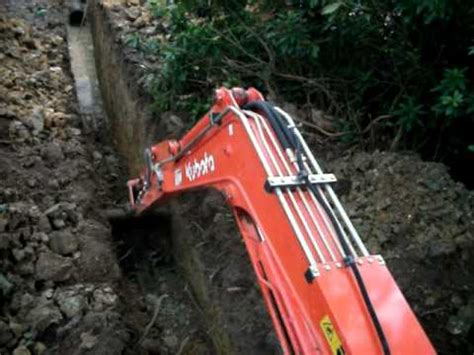 mini excavator digging hard clay youtube