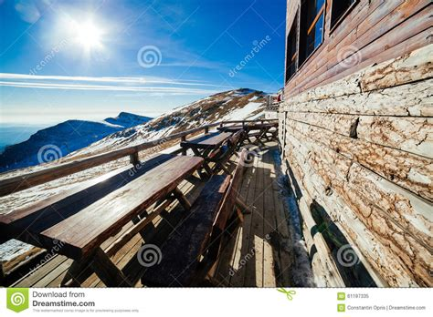 wooden tables on patio at ski resort stock photo image