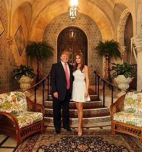 Donald and Melania Trump pose for a photo in front of