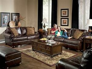 Living rooms with dark brown leather couches axiom for Brown leather sectional sofa ashley furniture