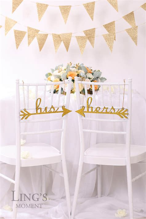 his and hers wedding chair signs glittered by