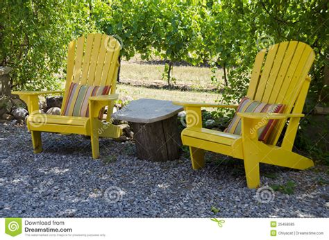 yellow adirondack chairs on a patio stock image image