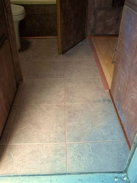 camping   rotted camper floor  tile