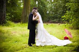 wedding photo poses in ivory wedding dress poses with groom in whimsical forest onewed