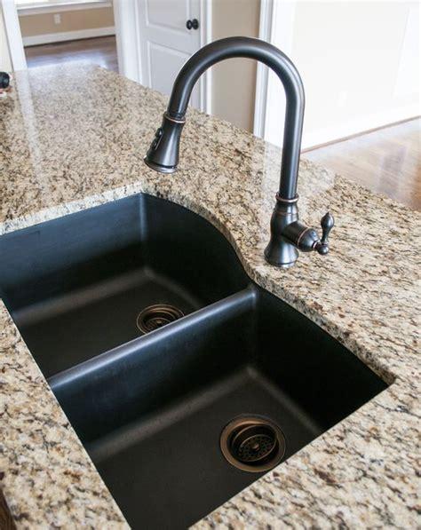 black granite composite sink with kohler rubbed bronze