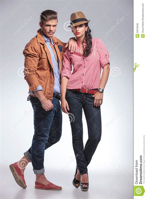 fashion couple posing  grey studio background stock