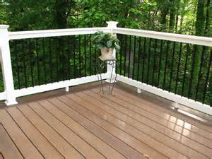 floor and decor alpharetta longevity black aluminum balusters with white pvc deck railing and wolf pvc decking amberwood
