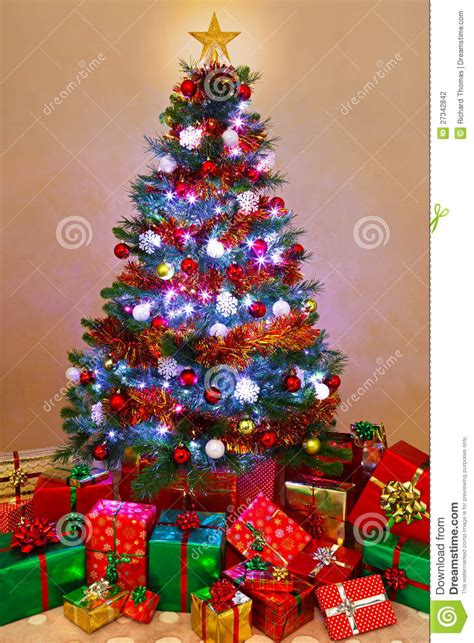 christmas tree in lights christmas tree with presents and lights merry christmas 5101