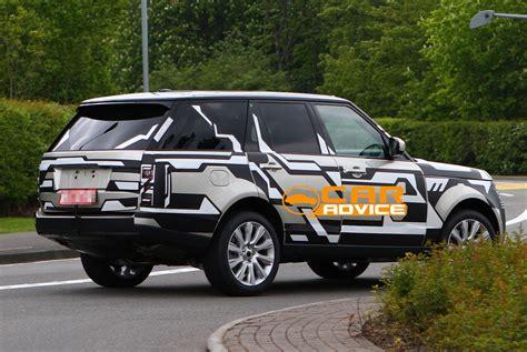 range rover spy shots reveal body   luxury suv